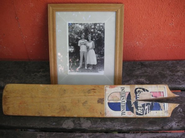 Cricket bat and wedding photo